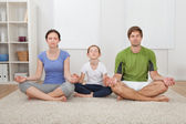 Family Practicing Yoga — Stock Photo