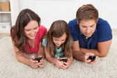 Family Using Smart Phones — Stock Photo