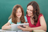 Woman and Girl Using Digital Tablet — Stock Photo