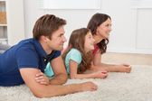Happy Family Lying On Rug — Stock Photo