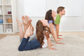 Active Family Doing Yoga — Stock Photo