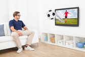 Man Watching Football On TV — Stock Photo