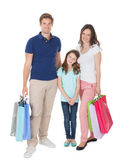 Smiling Family With Shopping Bags — Stock Photo