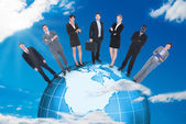 Business People Standing On Globe — Stock Photo