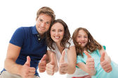 Happy Family Gesturing Thumbs Up — Stock Photo