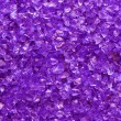Royalty-Free Stock Photo: Violet glass granules background