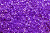 Violet glass granules background — Foto de Stock