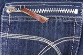 Blue denim jeans pocket with zip texture — Stock Photo