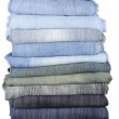 Stack of various jeans isolated on white background — Stock Photo #31209331