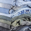 Stack of various jeans — Stock Photo