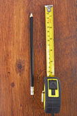 Laminate and tape measure and pencil — Stock Photo