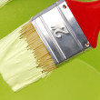 Paint brush and can with paint — Stockfoto