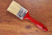 Paint brush on wood — Foto Stock