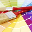 Color guide sampler and paint brush — Stock fotografie #33913553