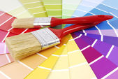 Color guide sampler and paint brush — Stockfoto