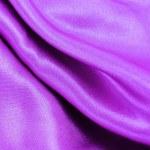 Purple silk fabric texture — Stock Photo #33996269