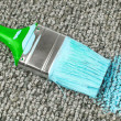 Stained carpet with paint brush — Stock Photo #34338493