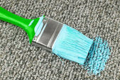 Stained carpet with paint brush — Stock Photo