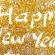 Happy New Year golden glittering background — Stockfoto