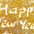 Happy New Year golden glittering background — Stock Photo
