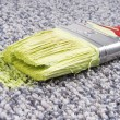 Paint brush on stained carpet — Stock Photo #38120627