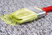 Paint brush on stained carpet — Stock Photo