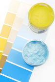 Paint brush and paint color choice for interior — Stock Photo