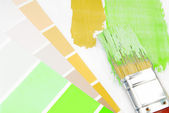 Paint brush and paint color choice for interior — Zdjęcie stockowe