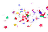 Confetti colorful flying isolated on white — Stock Photo