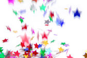 Confetti colorful flying isolated on white — Стоковое фото