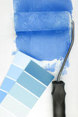 Paint roller and color chart choice — Stock Photo