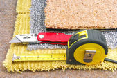 Carpet fitting with tools — Stock Photo