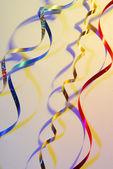Confetti serpentine ribbon with shadows — Stock Photo