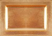 Golden empty plate surface texture — Stock Photo