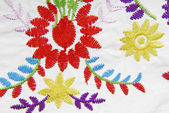 Embroidered fabric texture in old style — Stock Photo
