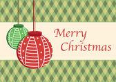 Tarjeta de navidad con bolas de navidad — Vector de stock