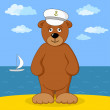 Teddy bear captain on sea coast — Stock Photo
