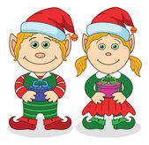 Christmas elves, boy and girl — Stock Vector