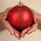 Holding christmas ball — Stock Photo