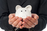 Holding piggy bank — Foto Stock