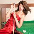 Woman playing billiards — Stock Photo #4177978