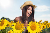Woman in sunflowers — Stock Photo