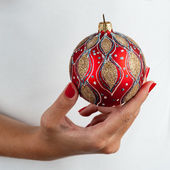 Holding christmas ball — Stock Photo