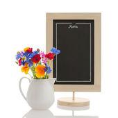Chalkboard and wildflowers — Foto Stock