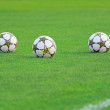 Soccer balls in green field — Foto de Stock