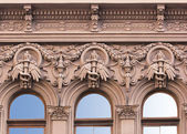 Building facade with decorative elements — Stock Photo