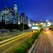 City in night with busy traffic — Stock Photo #12442435