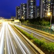 City in night with busy traffic — Stock Photo