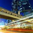 Stock Photo: Highway and traffic in city at night