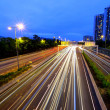 Highway and traffic in city at night — Stock Photo #12442485